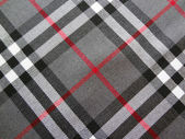 Texture of varicoloured tartan — Stock Photo