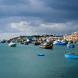 Fishing boats in Marsaxlokk village,  Malta — Stock Photo
