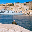 Alone fisherman in Grand Harbour Malta - Stock Photo