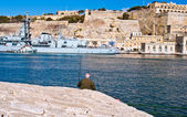 Alone fisherman in Grand Harbour Malta — Stock Photo