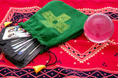 Tarot pack in a green pouch with cross on it isolated — Stock Photo