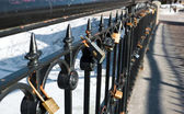 Locks on handrail — Stock Photo