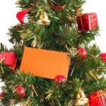 Christmas tree with card — Stock Photo #8223812