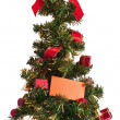 Christmas tree with blank card — Stock Photo