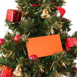 Christmas tree with card — Stock Photo #8224152