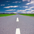 Cloudy road — Stock Photo