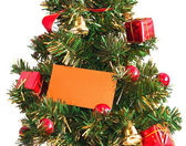Christmas tree with card — Stock Photo