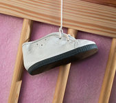 Children's boot on a cot — Stok fotoğraf