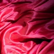 Royalty-Free Stock Photo: Red satin or silk background