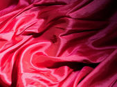 Red satin or silk background — Stock Photo