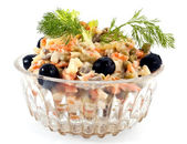 Salad from peas, carrot of a potato and olives — Stock Photo
