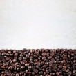 Coffee beans on the paper background — Stock Photo
