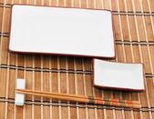 Chopsticks on bamboo mat — Stockfoto