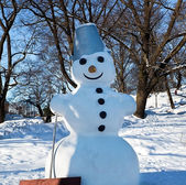Snowman in the city — Stock Photo
