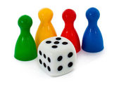 Board game figures and dice — Stock Photo