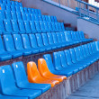Sits on stadium — Stockfoto