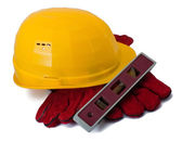 Building helmet, gloves and level — Stock Photo