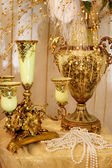 Candlestick, vase and pearls on table — Стоковое фото