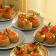 Tartlets with red caviar — Stock Photo #10641013