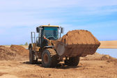 Gele bulldozer op construction desert chanel — Stockfoto