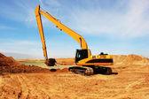 Orange excavator at Construction irrigation canal in Desert — Stock Photo