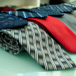 Red gray blue and others  necktie  on shelf — Stock Photo