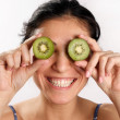 Smiling woman with  kiwi fruit — Stock Photo
