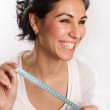 Smiling woman with tape measure in hands — Stock Photo