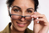 Smiling woman looking through the glasses — Stock Photo
