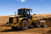 Yellow Bulldozer at Construction irrigation canal in Desert — Stock Photo