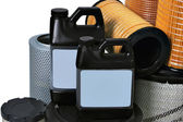 New automotive oil filter cartridge and plastic can — Stock Photo