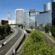 Modern buildings in the business district of La Defense to the west of Paris, France. — Stock Photo