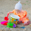 Child in sand box — Stock Photo