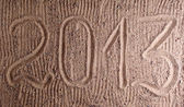 Inscription 2013 on sand — Stock Photo