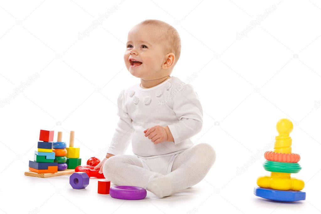Baby play with toys on white background in studio — Stock Photo #10155142