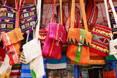 Colorful bags in a market in the street — Stock Photo