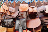 Leather bags in a market in the street — Stock Photo