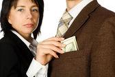 A woman takes a money — Stock Photo