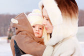 Mother with baby in winter — Stock Photo