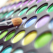 Color set of shades for a make-up of eyes with a brush — Stock Photo