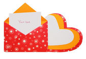 Heart from a cardboard and a card for records in a red envelope — Stock Photo