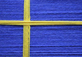 Flag of Sweden made of threads of dark blue and yellow color — Stock Photo