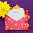 Pink envelope decorated with pastes — Stock Photo
