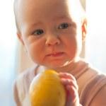 Baby with lemon — Stock Photo #8872277