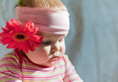 Baby with gerbera — Stock Photo