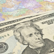 Dollars on the map — Stock Photo