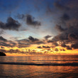 Sunset cloud at Pangandaran Beach - Stock Photo