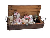 Old teddy bears in wooden box. Isolated. — Stock Photo