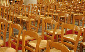 Wooden chairs in a French church — Stock Photo
