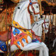 Wooden horses on an old carousel — Stockfoto